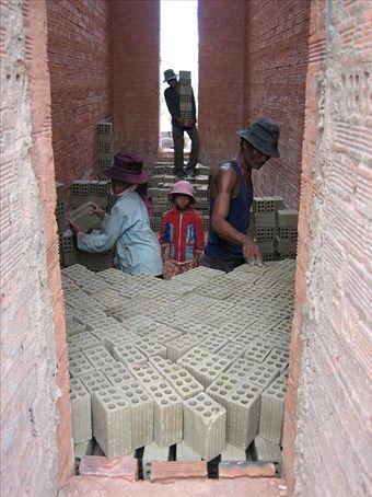 Stacking bricks for firing, Lac Lake, Vietnam Central Highlands