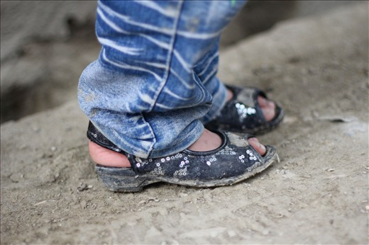 A young girl wears jeans and fancy shoes in a street in Kabul. Jeans were practically banned by the Taliban regime because of their Western origin while girls were not allowed outside the home. Now, just over a decade later, a girl is publicly wearing jeans in the street with sparkles on her shoes.