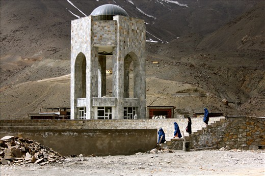 """Women wearing the burqa leave the tomb-cum-shrine of Ahmad Shah Massoud in Panjshir, Afghanistan.   Massoud is nicknamed the """"Lion of Panjshir"""" for his role in resisting the occupation of Afghanistan by the Soviet regime from 1979 to 1989. He is also a figurehead for his opposition to the Islamic extremism of the Taliban regime. Al Qaeda suicide bombers assassinated him September 9, 2001. The date now a national holiday in Afghanistan. The burqa is a piece of material covering a woman from head to foot, including her face. It was popularised during the Taliban regime in Afghanistan when it was illegal for a woman to be in public without wearing it."""