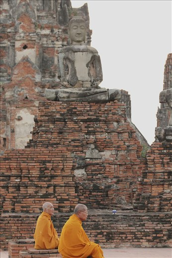 Two monks within the ruins of Ayutthaya, the ancient capital of Thailand