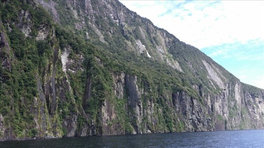 Super tall rock cliffs line the fjord. It's amazing. Surprising how green they are too.