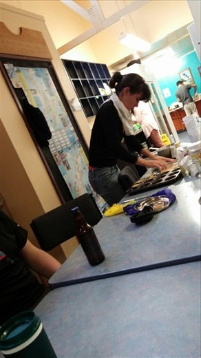 Intrepid hosteler making tarts in the hostel kitchen - she's improvising the rolling pin and tart cutter.
