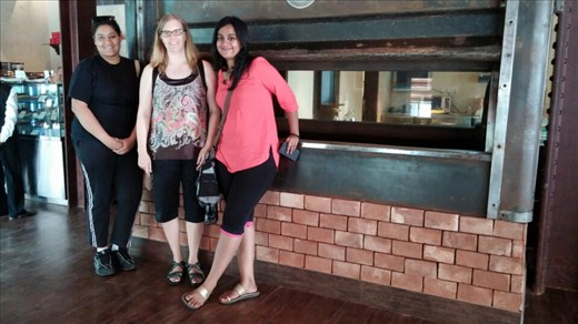 Anu and Shreya, the girls on the tour with me, in front of original oven at the great eastern hotel bakery