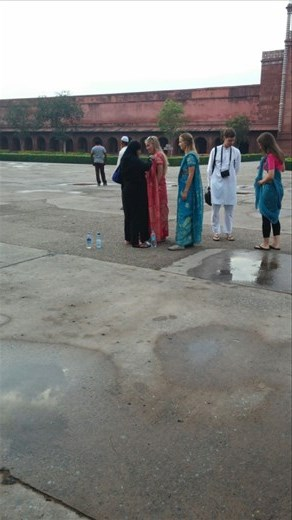 Tourists getting assistance with their saris