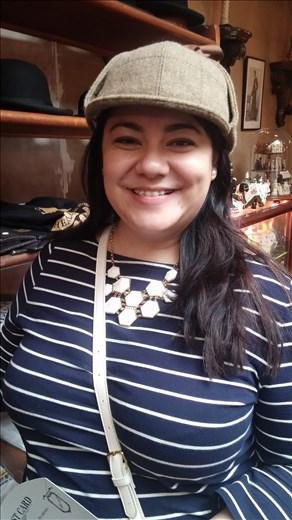 Liz in Sherlock's cap.