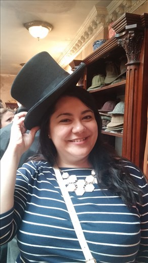 Liz tries on Sherlock's top hat.