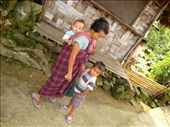 Tiny Eavesdropper- The little girl looks upon as the Khasi lady talks to her son.: by chayanika, Views[587]