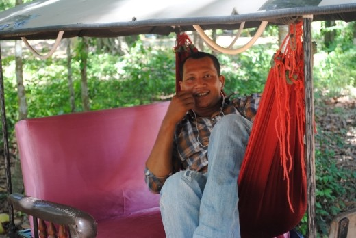 Hung, my private tuk tuk driver all day.  Taking a nap in his hammock waiting for me to finish.