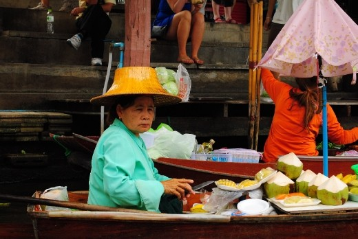 Floating market...this vendor giving Queen Elizabeth competition with her hat.