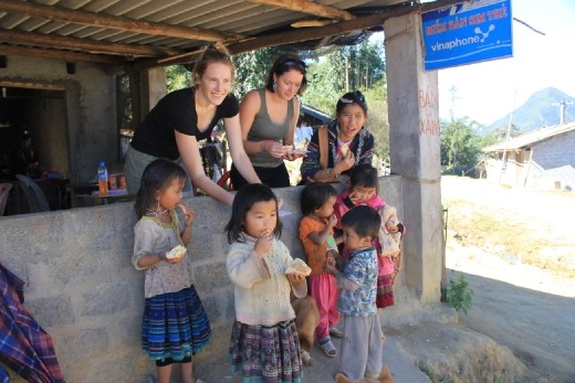 Giving children our leftover bread.  They are well fed but mainly eat rice, bread is a treat for them.