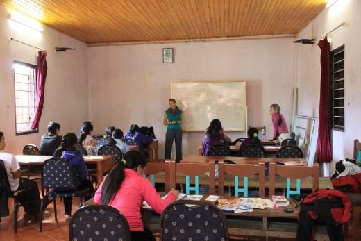 Marie teaching the kids at Sapa O'chau