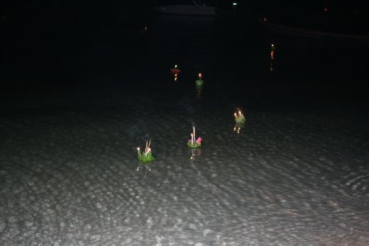 All of our krathongs floating out to sea...