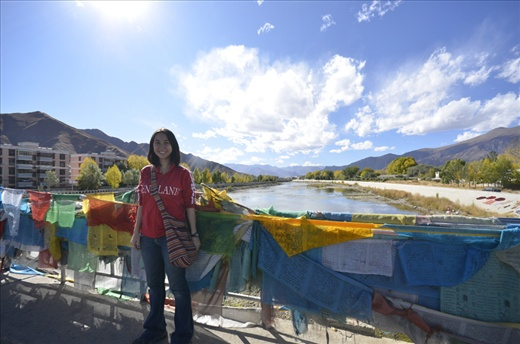 I am in front of the Kyichu River in Lhasa.