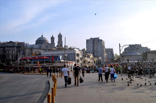The roads in Taksim Square remain empty while pedestrian tourists (since local Turks were banned from the square) filter around the police blockades.