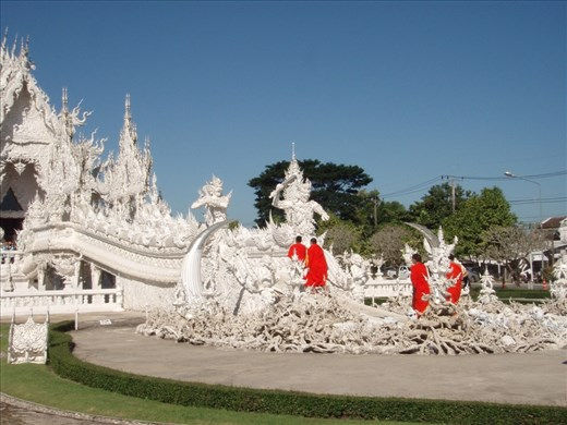 Buddhist monks create a splash of colour at the White Temple