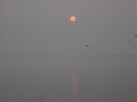 The sun rising over the river Ganga