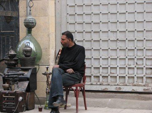 Guy smoking a sheesha in Islamic Cairo