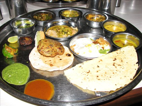 A partially filled thali platter