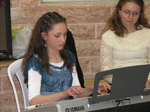 The Bat Mitzvah girl performing for her guests