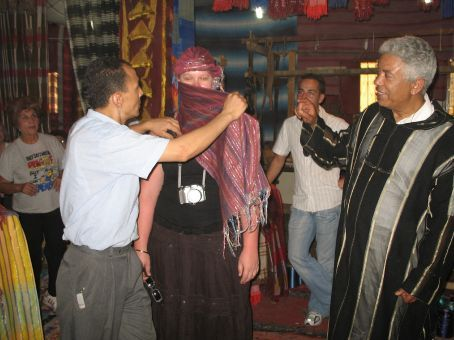 Krystal getting all wrapped up at the scarf souk (Fez)