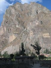 Distant view of mountain on which an Inca face is chiseled (center) and storage houses (right) were built by the Incas (Ollantaytambo): by colleen_finn, Views[219]