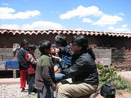 Applying face cream (Pumamarca)