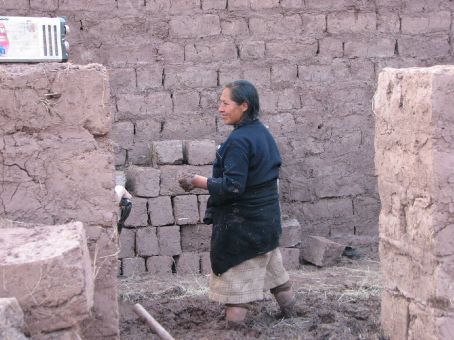 Crencenciana (the boys' mother) up to her knees in mud