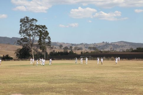 A game of cricket on the local oval.  Great to see  the Whites out.  I think this was in East Gresford.  (Chichester State Forest Camping trip, December 2009)