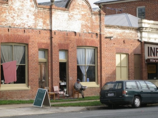 Just what you imagine about country towns; dude reading the paper slowly in front of his shop. (Holbrook NSW)