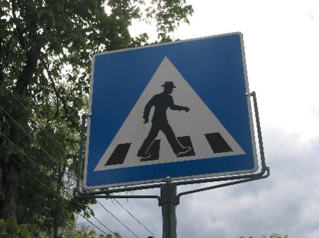I love the fact that the crosswalk man has smart pants and a hat on.