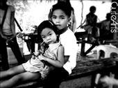 I was amazed by the expression of these kids from a small Barrio when they saw me holding a camera. The beauty and innocence of the subject drives me to take a snap.The photo conveys deep love and care of the older brother to her younger sister while riding the seesaw.: by cute_siony, Views[310]