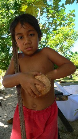 Local kid with coconut