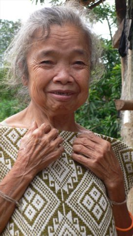 Little old lady with the scarf I just bought from her, around Muong Ngoi