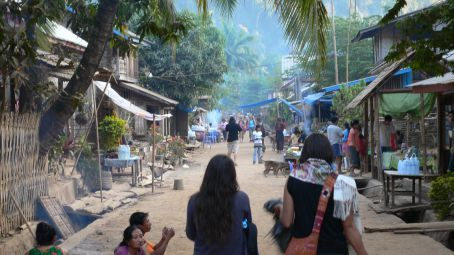 Muong Ngoi mainstreet; where falang (foreigners) and locals meet.