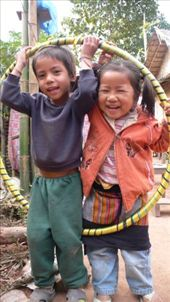 Lovely guesthouse kids happy with their gift from Rachal. - Muong Ngoi, Laos: by daan, Views[361]