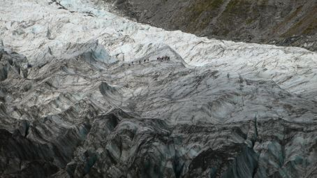 Note the small group of people hiking on the glacier