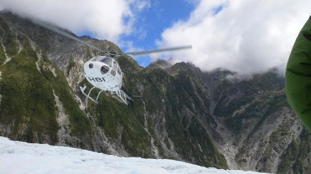 Helicopter lifting up after dropping us a couple of kilometers up the St. Joseph Glacier
