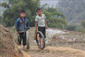 Often pictures are a matter of timing and I had to be very quick to take this right after these kids turned the corner and before the view was obstructed again. The normal day of these two children was spending their time playing with some old tyres: by dailylife, Views[203]