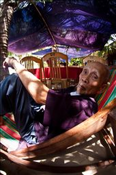 Escaping from the heat, an elderly man holds the secrets to an exultant life.: by dalexander, Views[184]