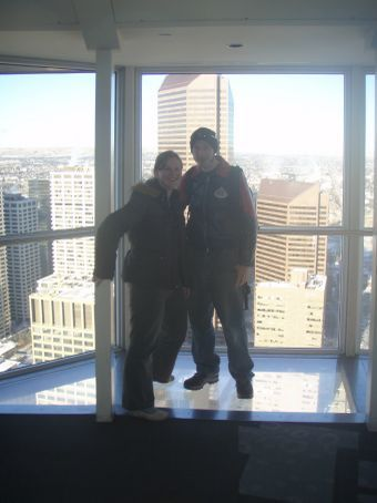 Dan and half of Stef on the glass floor at Calgary Tower