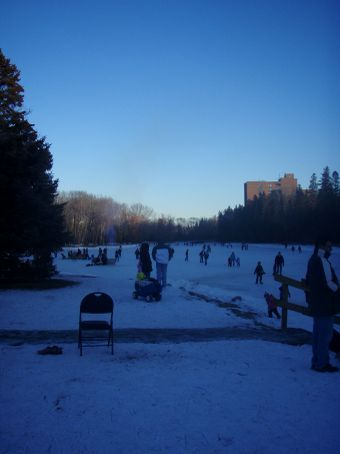 Lots of ice skaters and a fire pit on Bowness Lake