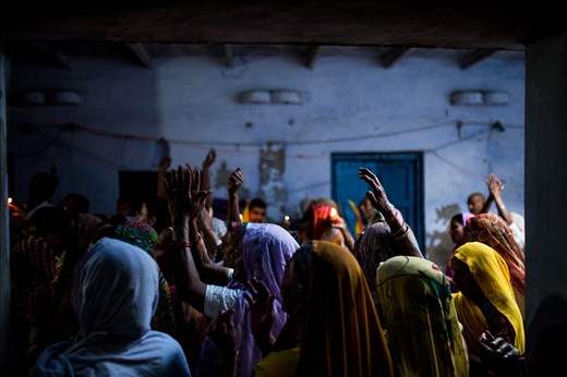 Women sing and dance in a local temple to celebrate Holi
