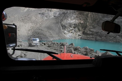 Crossing the dusty track on a 4 wheeler to the lake. The only way to access Atabad lake is by dusty road over the rubble of massive mountain landslide which occurred in early 2010.