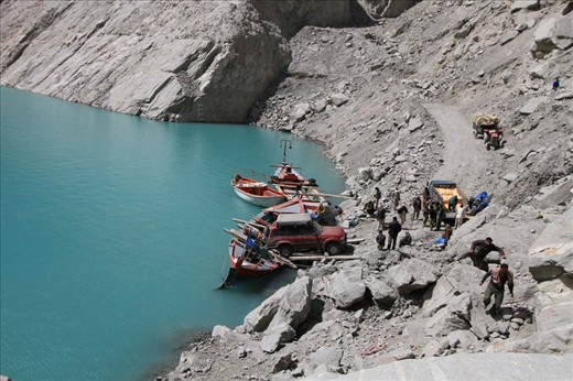 Vehicles and goods are being transferred via local unsafe boats since the landslide blocked river flow that resulted in a lake that submerged 20 km of the main Karakoram Highway to other villages and southern China.