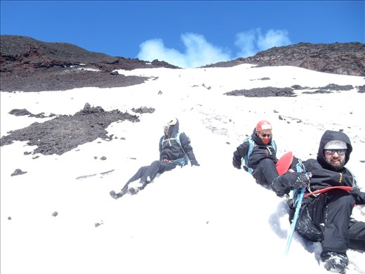 Trip down the volcano was a lot faster than the trip up. Our backpacks came complete with snow gear and a mini slide.