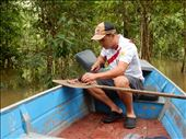 Our guide preparing chunks of beef to fish for piranha.: by danidawnandstevo, Views[136]
