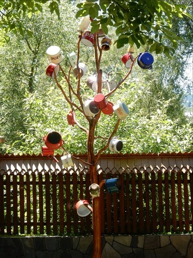 Pots on a tree lets you know there is a young unmarried woman in the house. The more pots the richer the family.