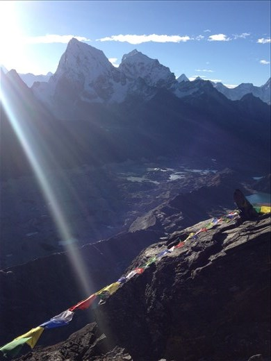 Top of Gokyo Ri just as the sun comes over Everest.