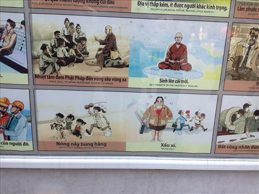 A Buddhist cause and effect list displayed outside the pagoda.