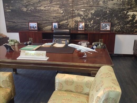 Presidents desk. His wife was a ex airline stewardess explaining the airplane on the desk.
